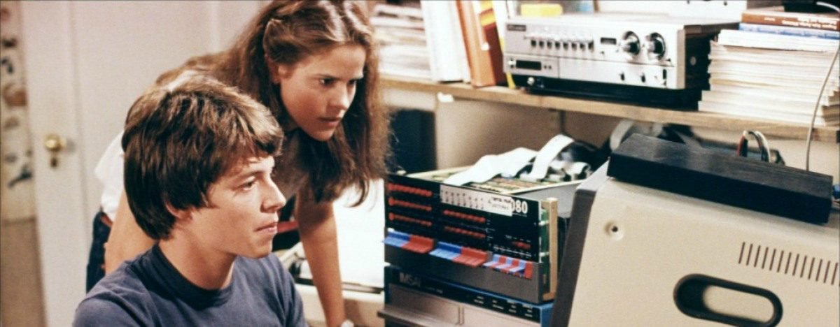 Matthew Broderick shows Ally Sheedy how to use a word processor, presumably.